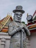 Statua di pietra cinese a Wat Pho a Bangkok fotografia stock