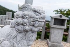 Statua di pietra del leone della roccia Immagini Stock