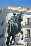 Statua di re Carlos III, a Puerta del Sol, Madrid immagine stock libera da diritti