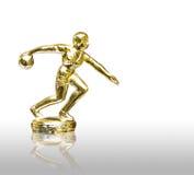 Statua dorata del giocatore di bowling isolata Fotografia Stock