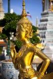 Statua dorata del kinnon (kinnaree) Immagini Stock