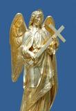 Statua dorata dell'angelo fotografia stock