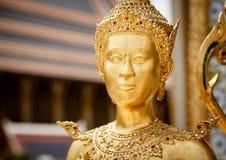 Statua dorata di Kinnari Immagine Stock
