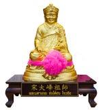 Statua dorata di un dio cinese Fotografia Stock