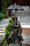 Statua nella pioggia Immagine Stock