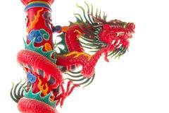 Statua rossa del drago sul palo Immagini Stock