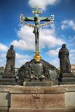 Statuary of the St. Cross with Calvary on the Charles Bridge Ka. Rluv Most in Prague, Czech Republic Royalty Free Stock Image