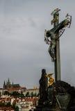 Statuary of St. Cross , Calvary , in Charles bridge, Prague.Czech Republic. Crucifixion statue on Charles Bridge in Prague Stock Photo