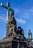 Statuary of St. Cross , Calvary , in Charles bridge, Prague.Czech Republic. Crucifixion statue on Charles Bridge in Prague Stock Photos