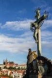 Statuary of St. Cross , Calvary , in Charles bridge, Prague.Czech Republic. Crucifixion statue on Charles Bridge in Prague Stock Image
