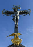 Statuary of St. Cross , Calvary , in Charles bridge, Prague.Czech Republic. A large crucifix with Jesus Christ, open-air view of a close-up . Charles bridge Royalty Free Stock Photo