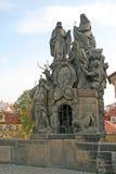 Statuary of St. John of Matha, St. Felix of Valois and St. Ivan on the Charles Bridge in Prague, Czech Republic. PRAGUE, CZECH REPUBLIC - APRIL 18, 2010 stock photo