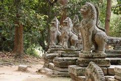 Statuary at temple at Angkor Wat, Cambodia. Ancient ruins of statuary outside temple at Angkor Wat, Cambodia Royalty Free Stock Photos