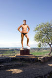 Statuary. Young man in pose as an ancient Greek statue of an athlete Stock Photography