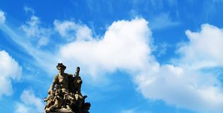 Statue. And blue sky Royalty Free Stock Photo