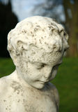 Statue. Old graveyard statue of a young boy, stone Stock Photo