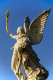 Statue. Iris, carrying the fallen hero to Mount Olympus , statue on Schlossbrucke bridge , Berlin Royalty Free Stock Image