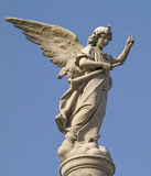 Statue. Stone statue of an angel with a trumpet in his hand Stock Photos