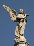Statue. Stone statue of an angel with a trumpet in his hand Stock Image