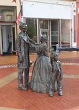Statue of Abe Lincoln, Mary Todd Lincoln, and Son, Springfield, IL. The statue of the Lincoln family stands in front of the former Lincoln Law Offices and across royalty free stock images