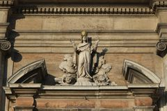 Statue above the entrance to Cathedral in Cesena city, Italy stock photography