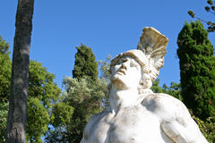 Statue of Achilles. Trying to remove the arrow from his hill Royalty Free Stock Photo