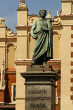 The statue of Adam Mickiewicz in front of the cloth hall Royalty Free Stock Photo