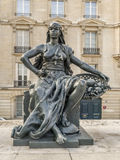 Statue of Africa in front of d`Orsay Museum. PARIS, FRANCE - 25 AUGUST, 2013 - One of six statues representing six continents - Africa, outside of d`Orsay Museum royalty free stock image