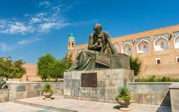 Statue of Al-Khwarizmi in front of Itchan Kala in Khiva, Uzbekistan Stock Images