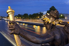 The Statue of the Alexander III Bridge stock photo