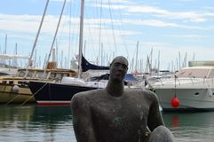 Statue in Alicante Harbour - Art Sculpture Outdoor Marina Refection Boats Sailing Yachts Stock Images