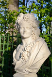 Statue of Allegory of Autumn (Bacchus). Statue of Allegory of Autumn (Bacchus) in Summer Garden, St.Petersburg, Russia. Dionysus - in Greek mythology, the Royalty Free Stock Photo