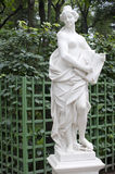 Statue of allegory of mercy in a summer garden Stock Images