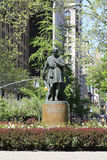 Statue of American actor Edwin Booth as Hamlet at Gramercy Park. NEW YORK - MAY 7, 2015: Statue of american actor Edwin Booth as Hamlet at Gramercy Park by Royalty Free Stock Photo