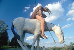 Statue of American Indian on a pinto horse Stock Photo