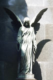 Statue of ancient angel on cemetery Royalty Free Stock Photos
