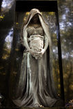 Statue of ancient angel on cemetery. In Warsaw Royalty Free Stock Photos