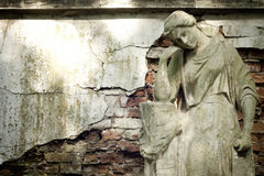 Statue of ancient angel on cemetery Stock Photos