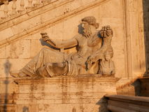 Statue of an ancient god on the Capitoline hill in Rome Royalty Free Stock Image