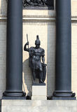 Statue of an ancient warrior in medieval armor Stock Images