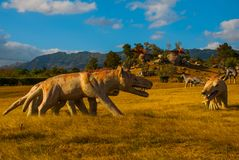 Statue of an ancient wolf in the field. Prehistoric animal models, sculptures in the valley Of the national Park in Baconao, Cuba. stock image