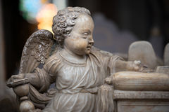 Statue of angel boy in church. Sweden, Europe. White statue of angel boy in church. Sweden, Scandinavia. Europe travel Royalty Free Stock Images