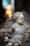 Statue of angel boy in church. Sweden, Europe. White statue of angel boy in church. Sweden, Scandinavia. Europe travel Royalty Free Stock Photos