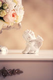Statue of an angel and a bridal bouquet. On the dresser in the interior Royalty Free Stock Photos