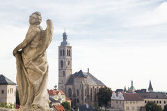 Statue of an Angel and church of St. James, Kutna Hora. Statue of an Angel and church of St. James in a historical centre of town Kutna Hora in the Czech Stock Photos