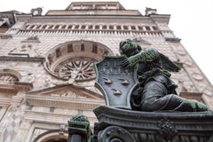Statue of an angel at the Colleoni Chapel in Bergamo high. Bronze statue of an angel on the fence at the entrance to the Colleoni Chapel in Bergamo high royalty free stock photography