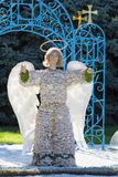 Statue of angel. Dressed into the hand made flowers costume royalty free stock images