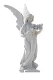 Statue of an angel with flowers isolated Royalty Free Stock Photo