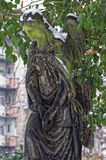 Statue of an angel with her head bent low Stock Photos