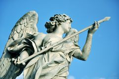Statue of angel holding the holy lance. Marble statue of angel holding the Holy Lance of Longinus. Sant`Angelo bridge balustrade. Rome, Italy Stock Photography